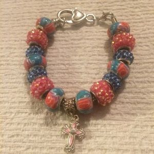 Jewelry - Pink Cross on a Bed of Roses bracelet
